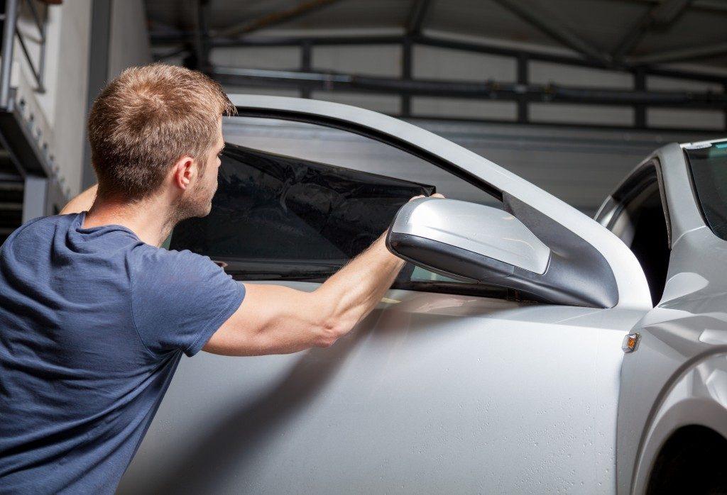 a man applying a car tint