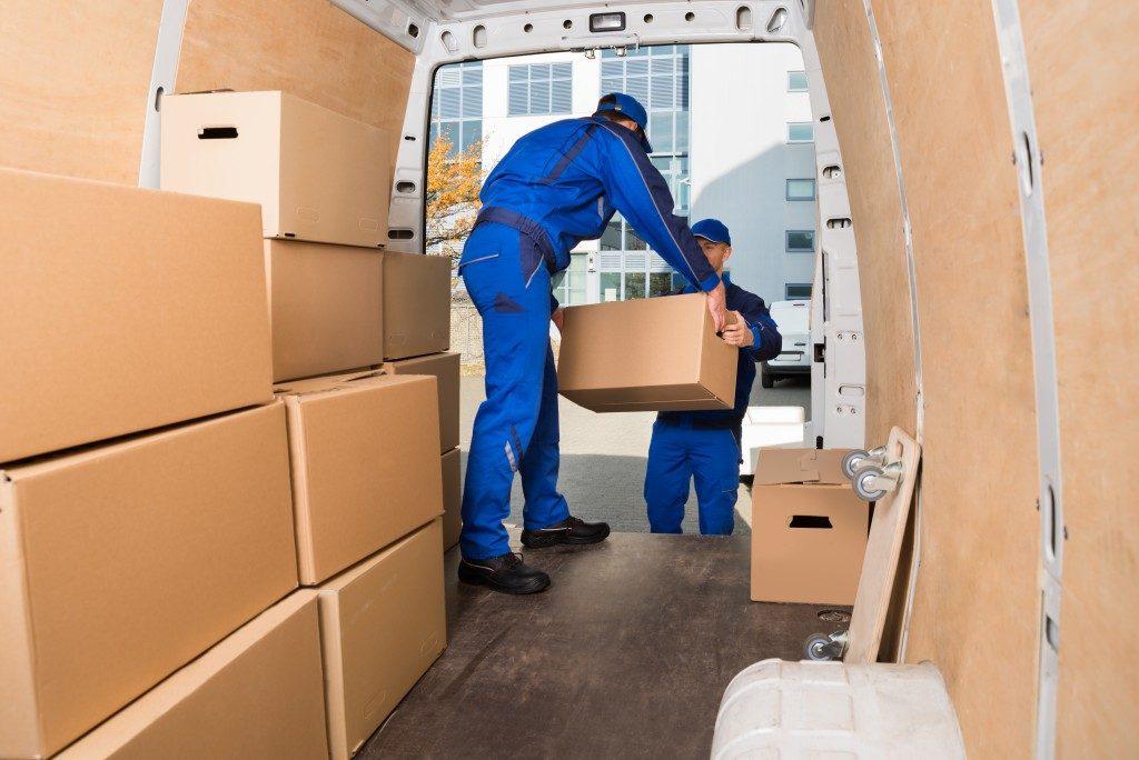 men loading boxes into van