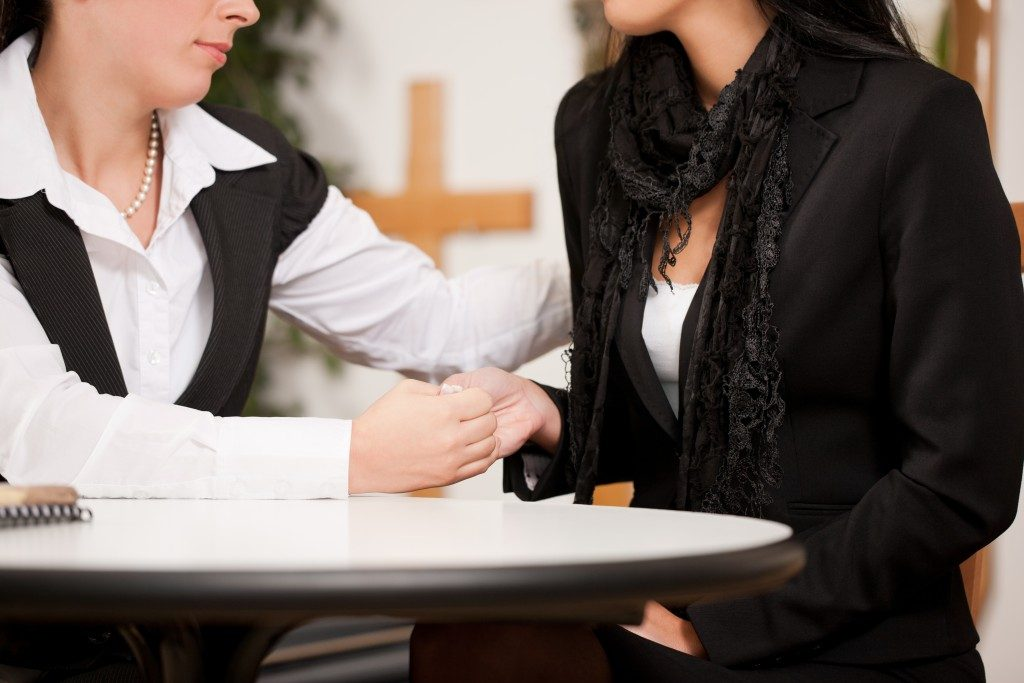 Woman consulting an funeral agent