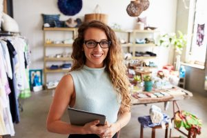 Business owner posing inside her shop