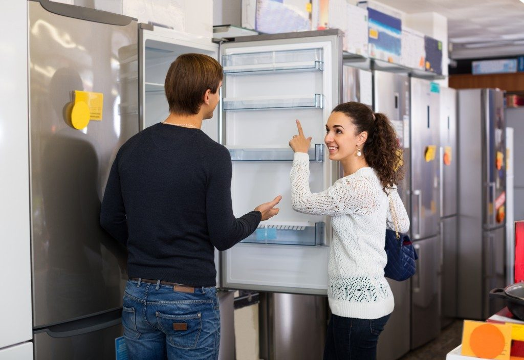 Couple choosing a refrigerator