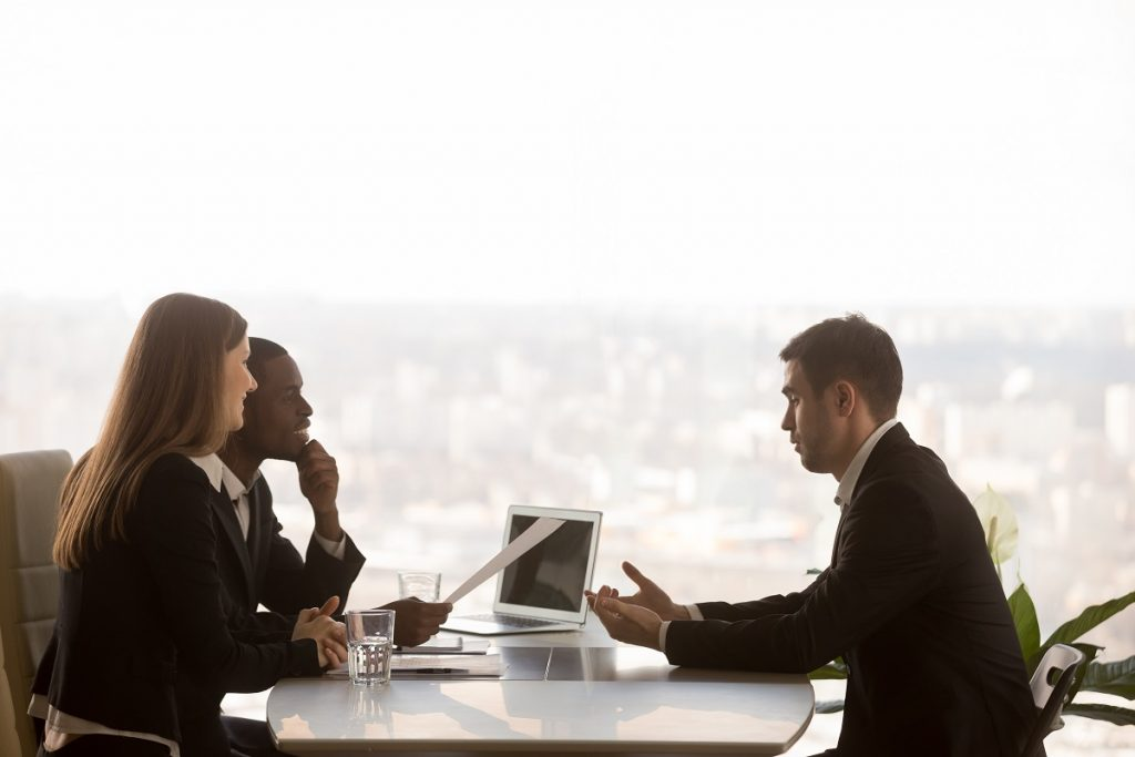 Human resources interviewing a male applicant