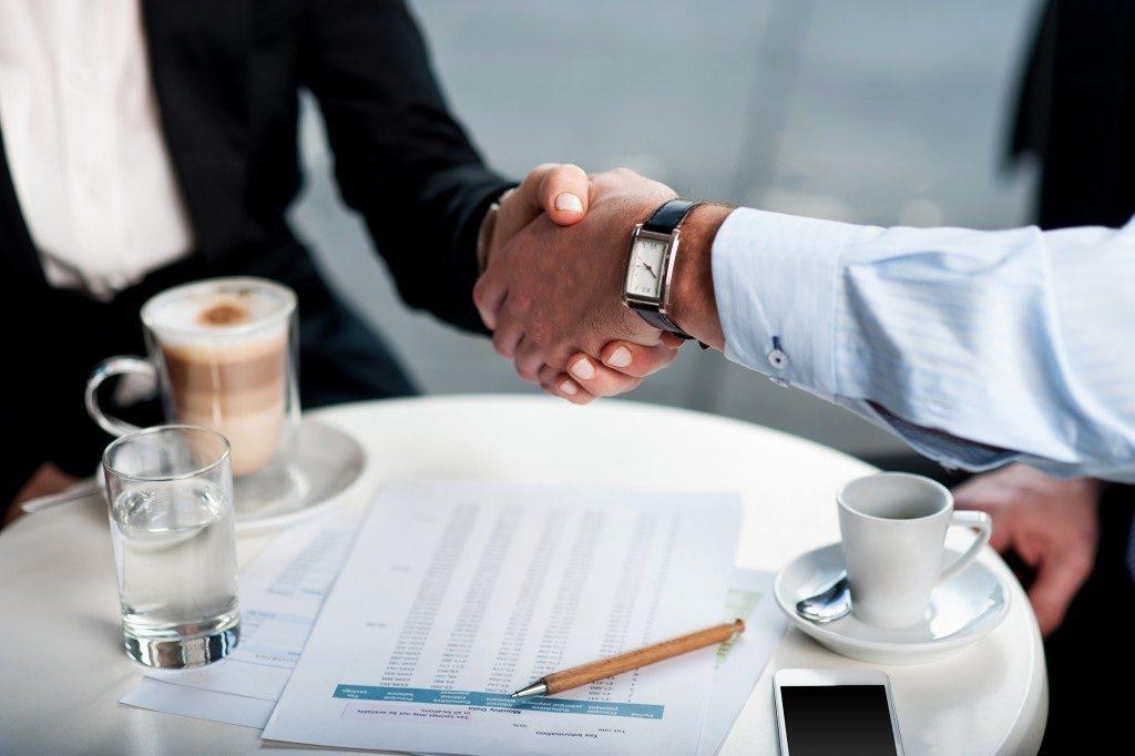Businessman with client handshake