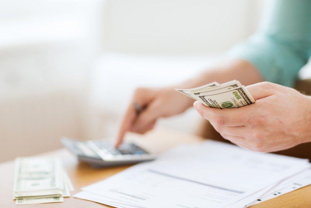 Man computing his money