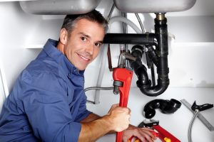 Plumber fixing the water hammer