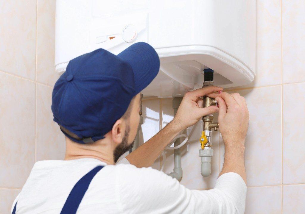 man fixing shower