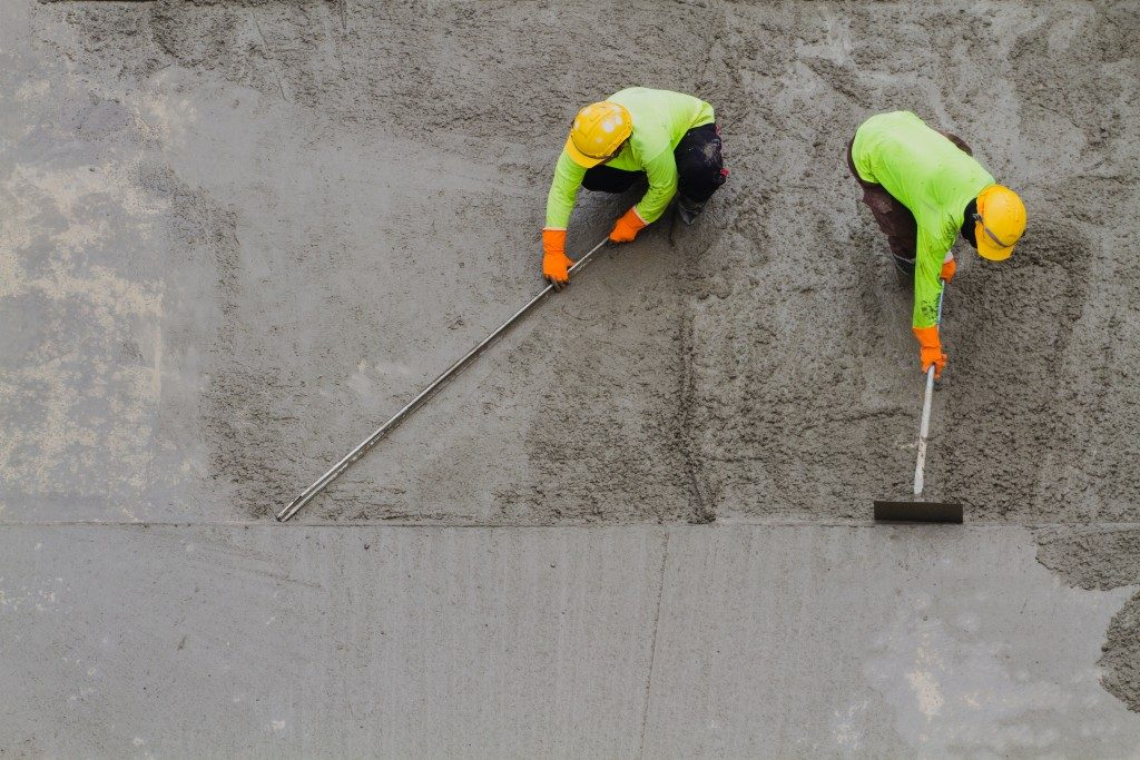 Construction workers placing cement