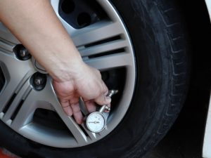 Car owner checking the wheel