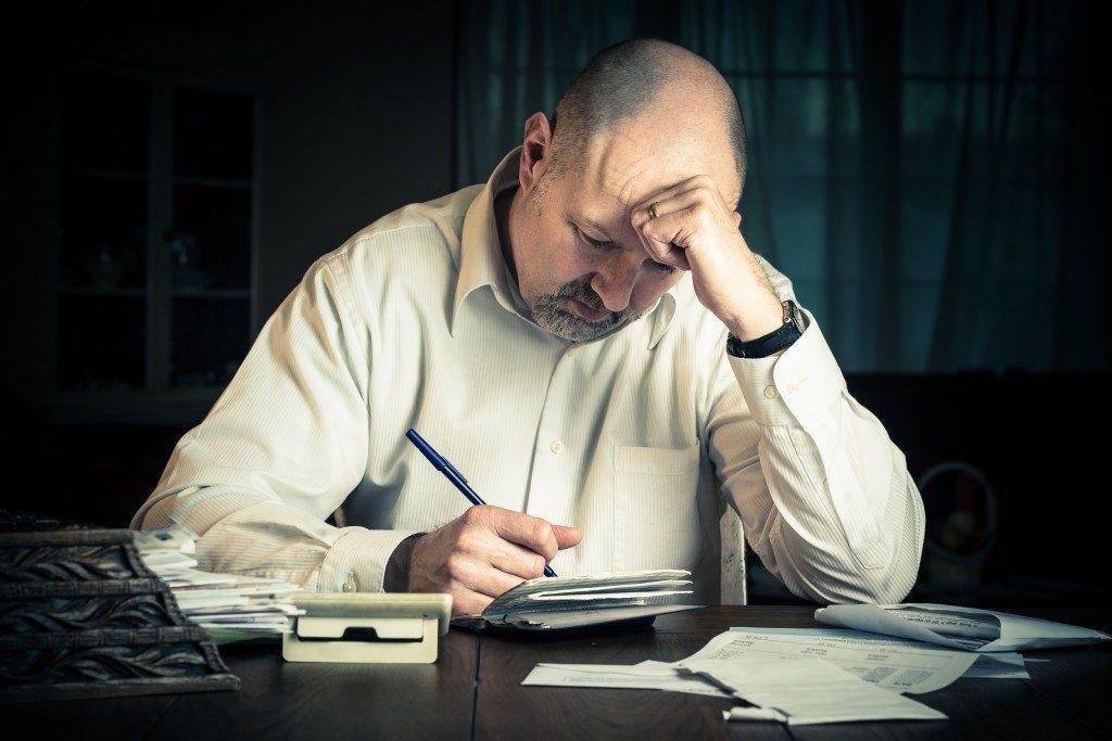 Businessman computing his finances