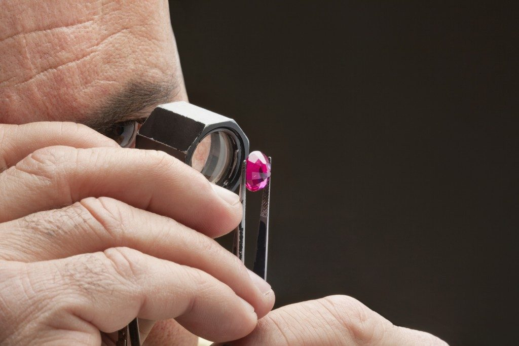 Jeweler inspecting a ruby