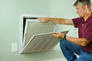 Man checking air filter