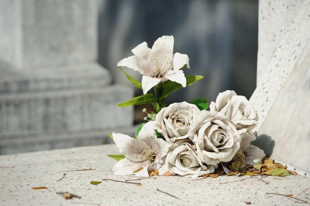 old flower on grave