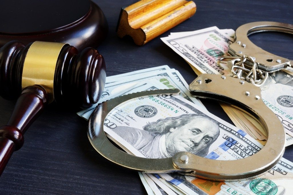 gavel with dollars and handcuffs, bail bond concept