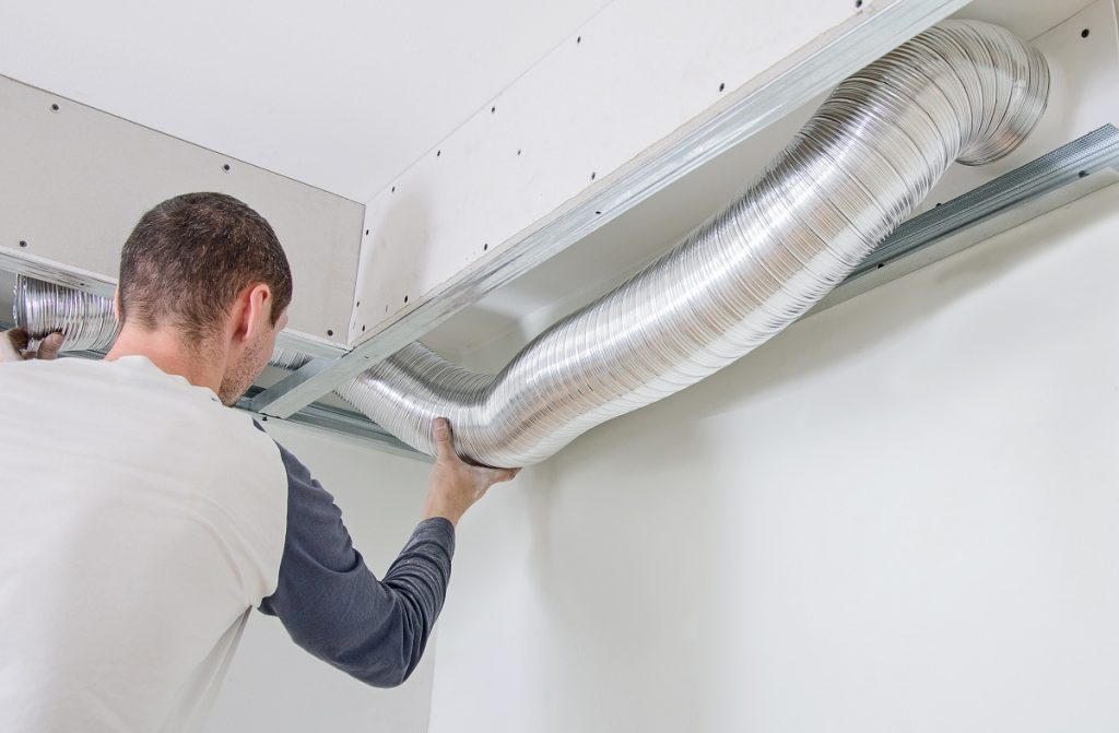 Man checking vent filter
