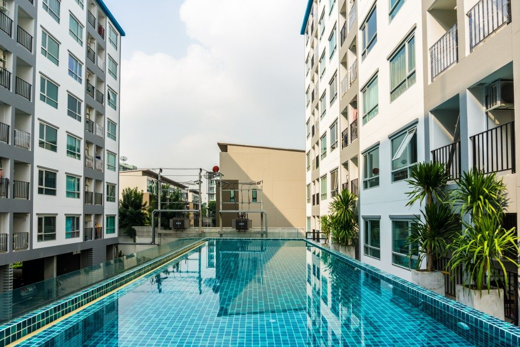 Swimming pool among high rise condo buildings