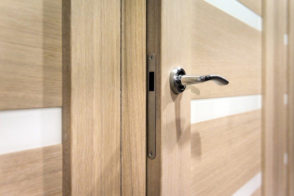 door knob installed in a wooden door