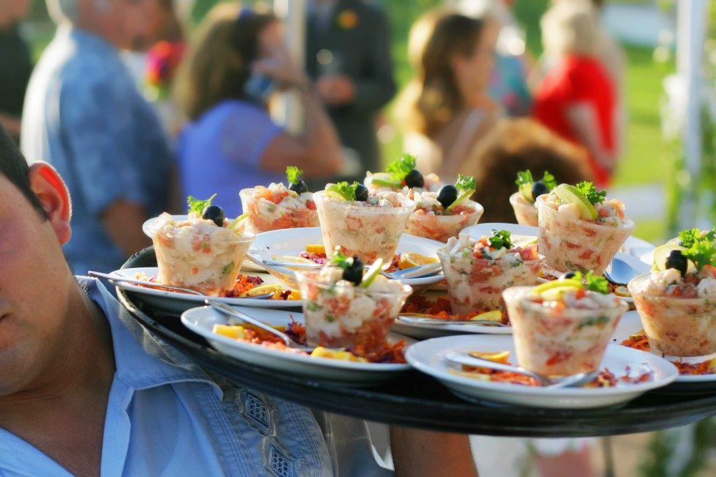 food waiter serving at an event