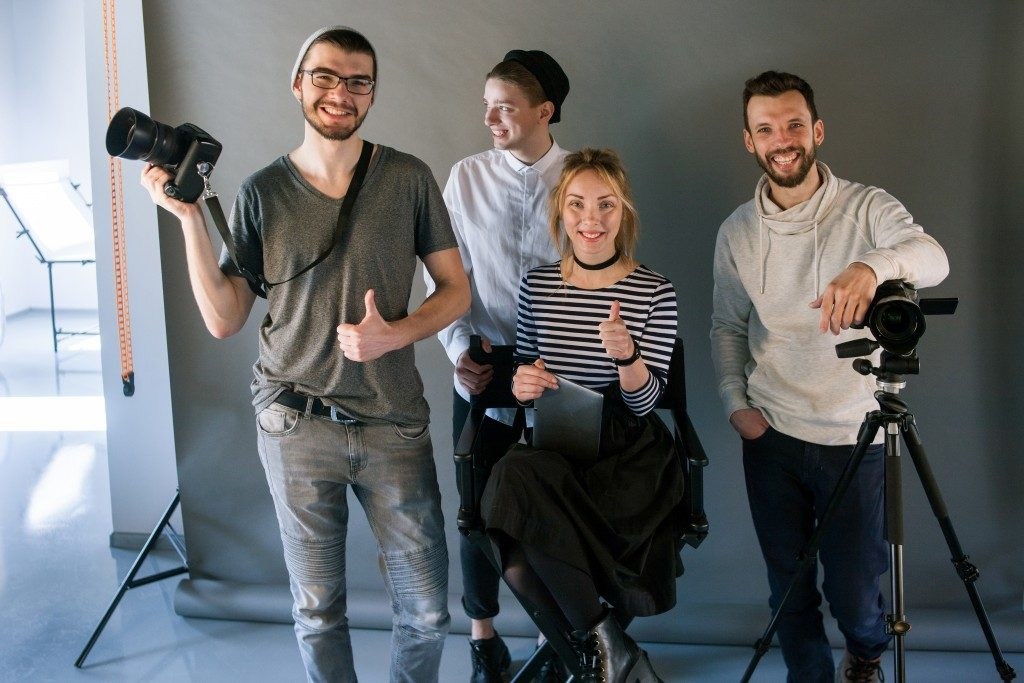 photographers posing in a photobooth