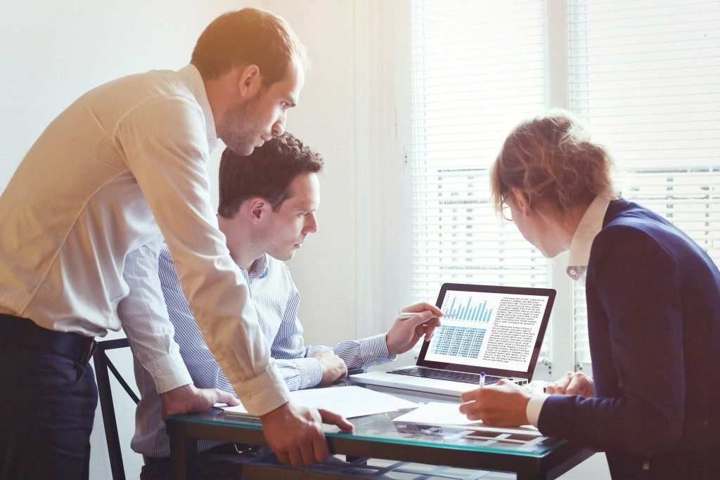 three executives analyzing data