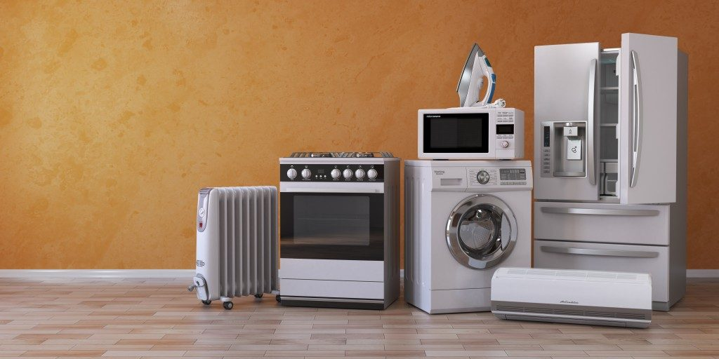 house appliances all in silver colors in orange background