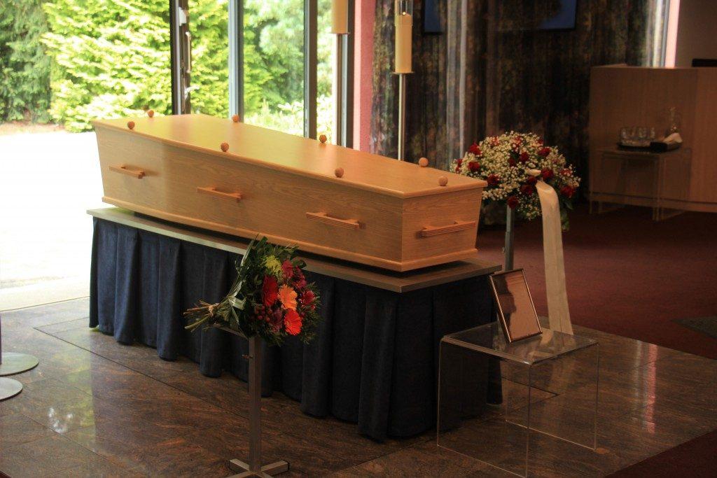 wooden casket inside a church