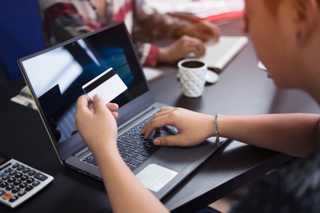 Applying credit card services online using laptop
