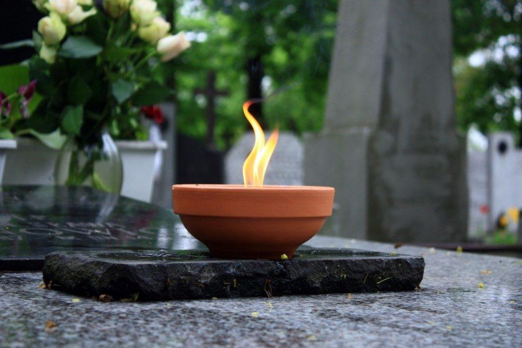 candle at a graveyard