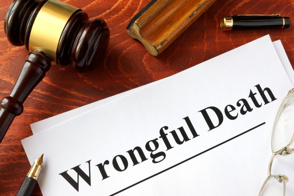 Document with title Wrongful Death o a wooden surface
