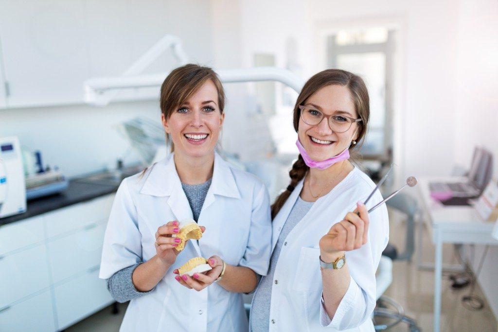 Dentist holding dental equipment
