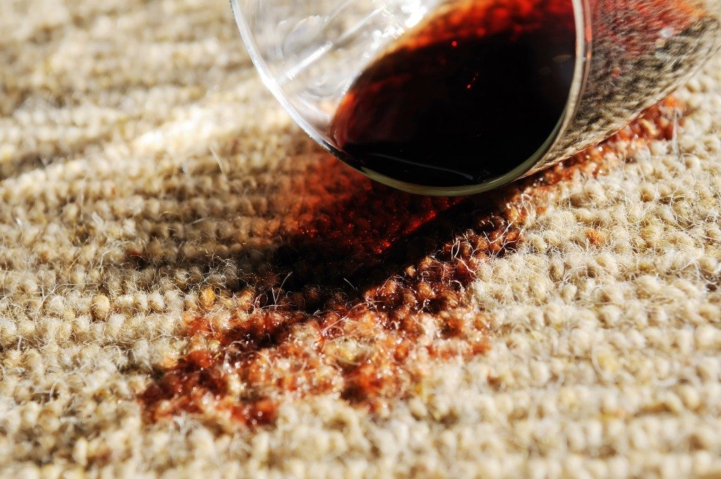 A glass of red wine spilt on a pure wool carpet
