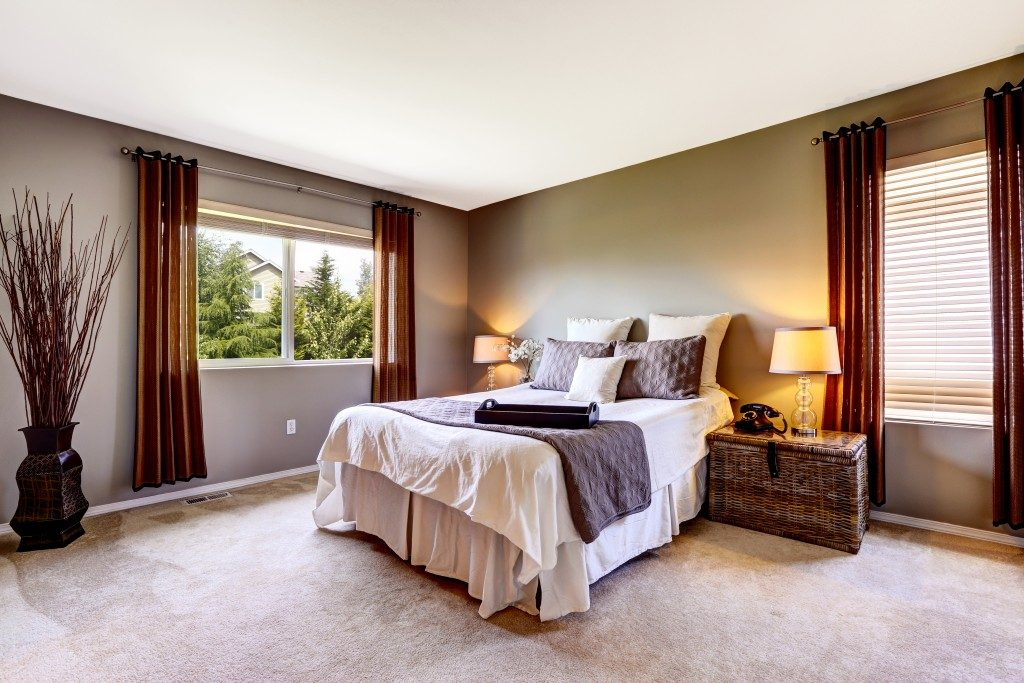 Bedroom interior with carpet floor and big bed