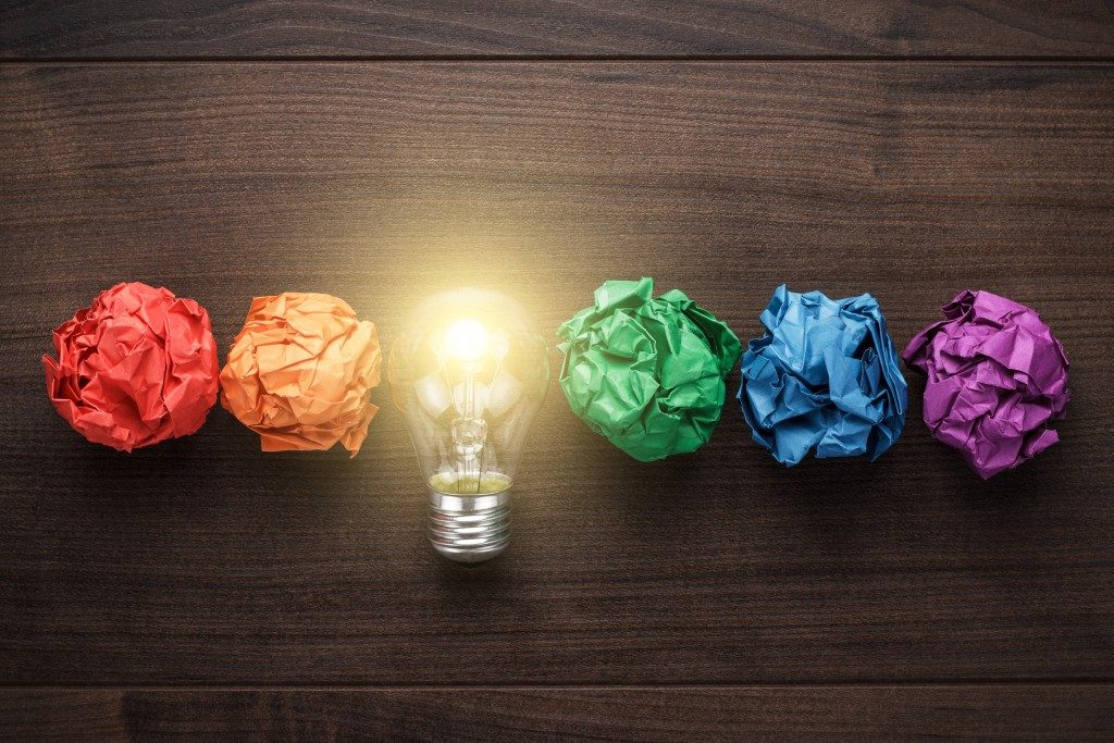 colorful crumpled papers and a lightbulb