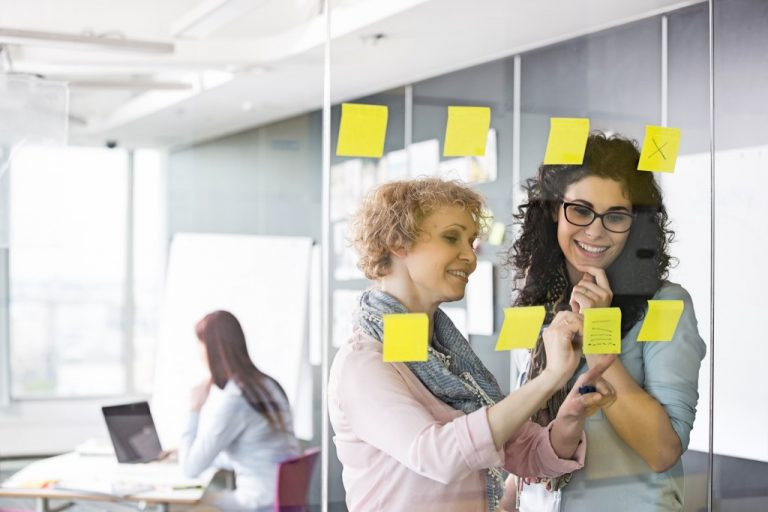Colleagues with sticky notes