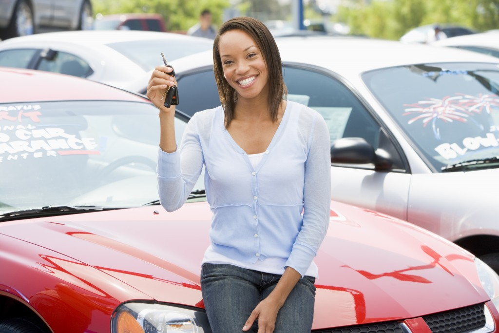 Woman picking up car from lot