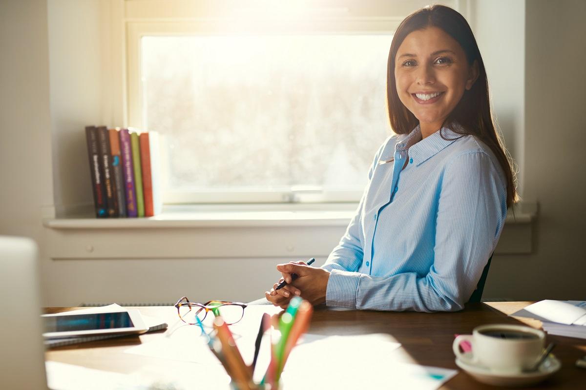 smiling employee near window