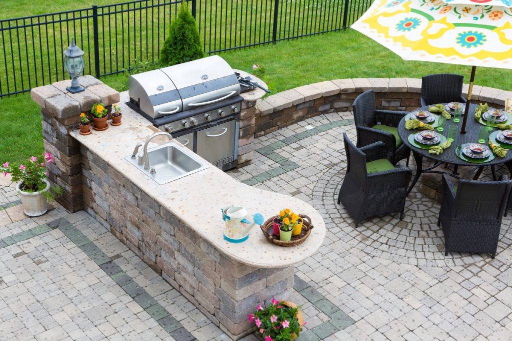 outdoor dining and kitchen area