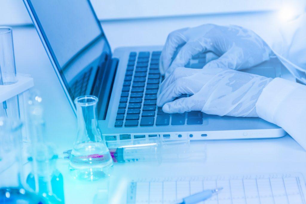 lab technician using laptop