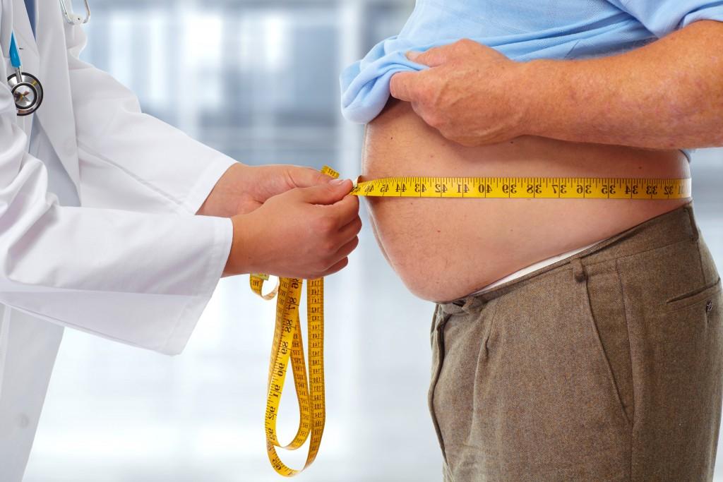 man having his waist measured