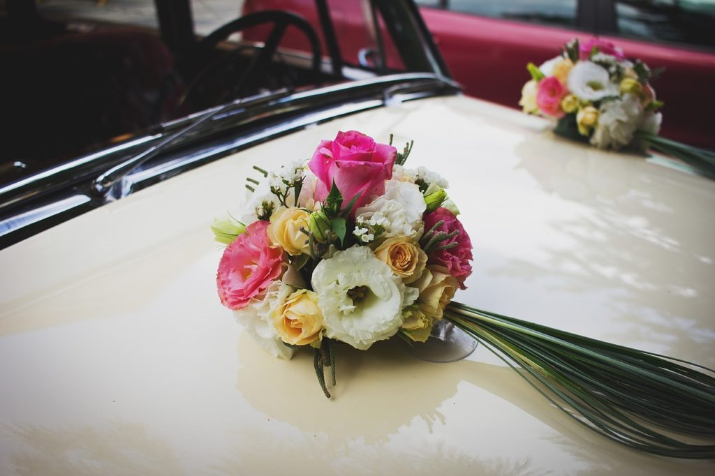 flowers on a bridal car