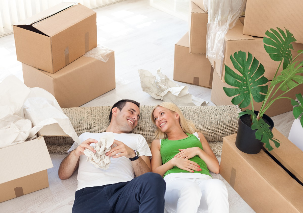couple relaxing in the middle of boxes