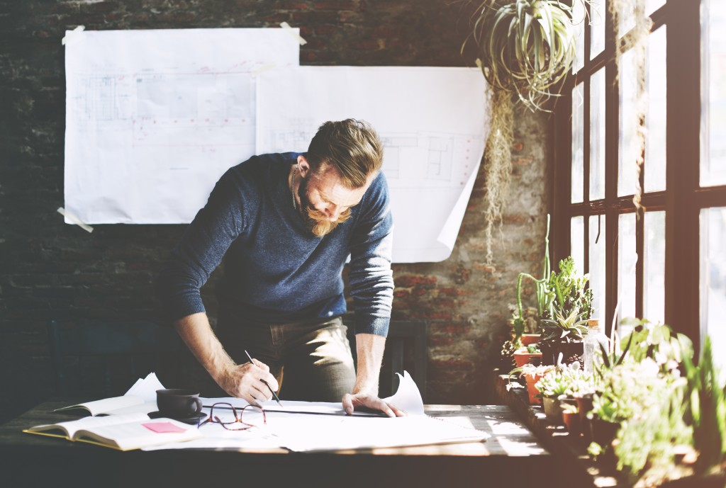 man working while standing