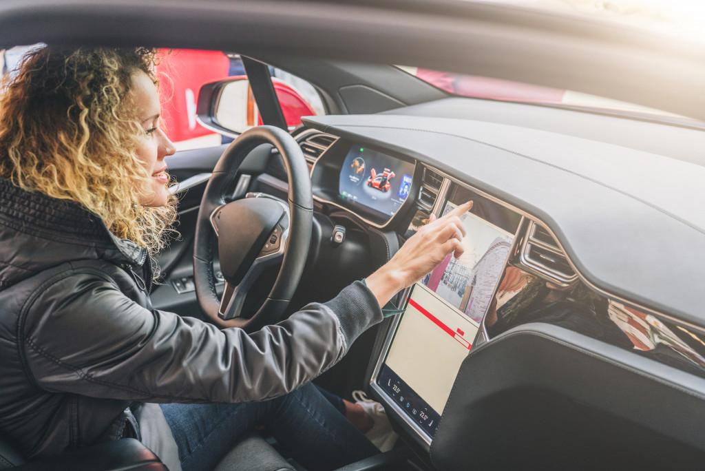 woman navigating car gps
