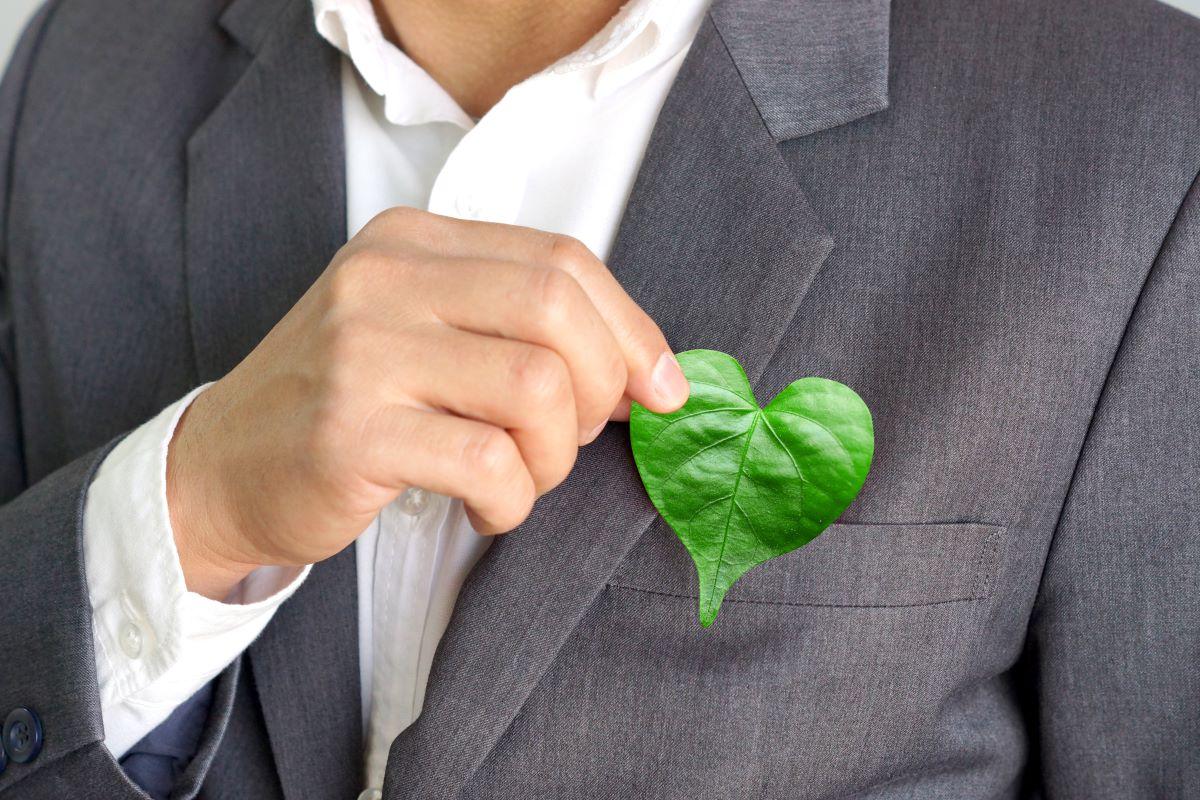 man holding a heart shaped leaf