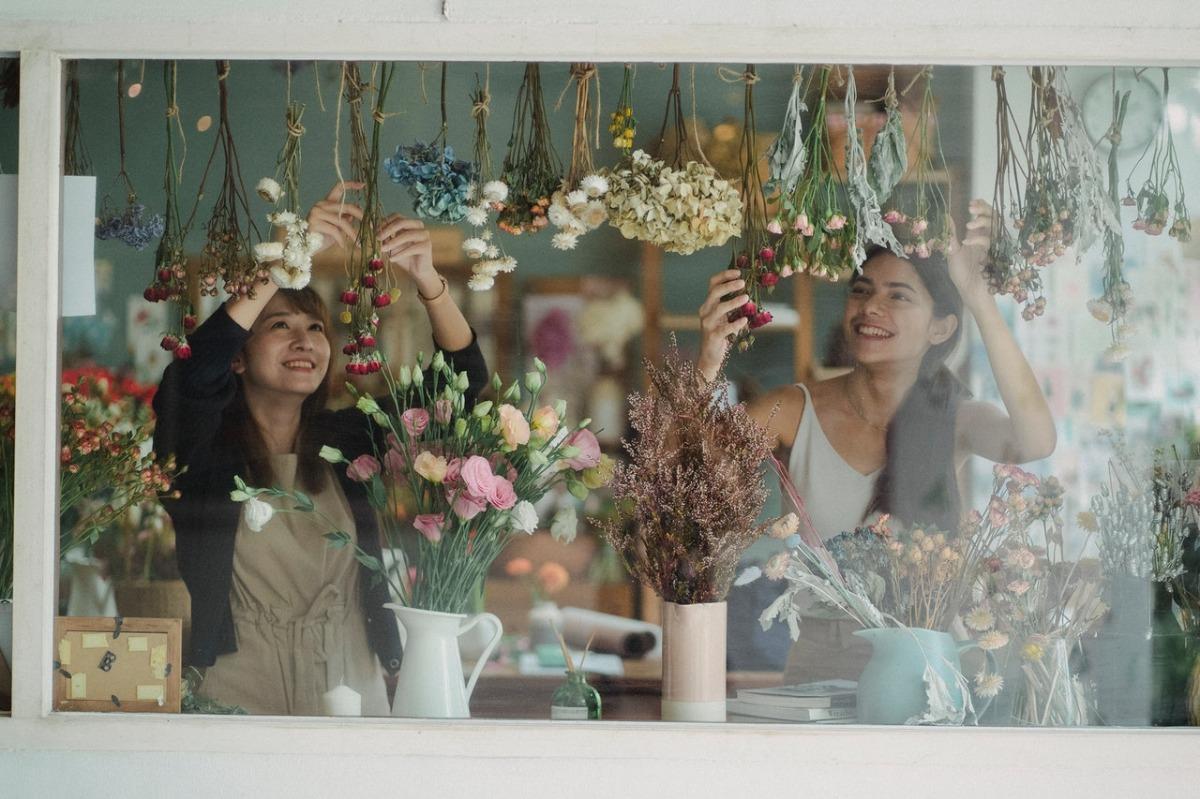 women organizing flowers