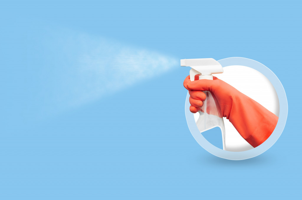 spraying a disinfectant