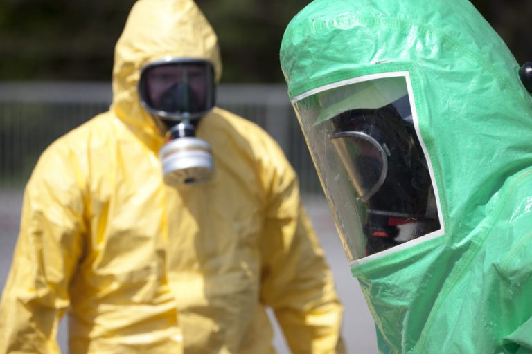 2 people wearing hazmat equipment